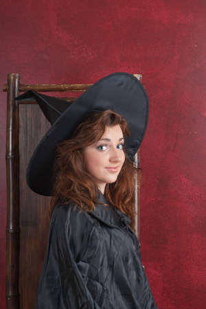 Young girl in witch hat and cape