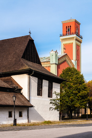 Wooden articular church built in 1717 and New red protestant church built in 1894 in Kezmarok, Spis region, Slovakia. Old one is registered in UNESCO List of the World Cultural Heritage