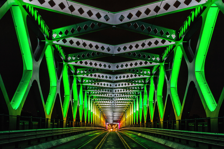 symetry: 9. october 2016 - Bratislava, Slovakia: Old bridge ceremoniously lightened during White night, contemporary art festival of lights.