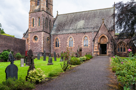 Saint Andrews Church, landmark in Fort William, Scotland, United Kingdom. Cloudy rainy day and calm atmosphere.