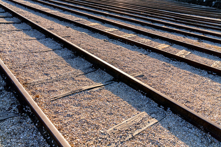 Perspective view of multiple train rails as diagonal lines. Railway engineering or transportation theme background.