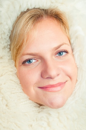 sheep skin: The girl has taken cover a warm sheep skin