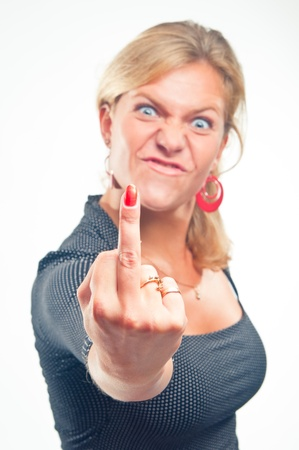 angry women: The malicious girl on a white background shows crude gesture