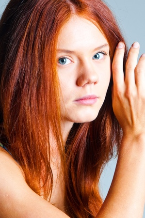 The red-haired girl on a gray background Stock Photo - 9054777
