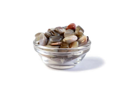 Natural Agate in small bowl, various types and color, gems mineral collection as nice natural background