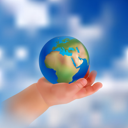 mothering: childs hand holding a globe. Peace in the hands of a child. Hand on a background of sky and clouds. Realistic objects.