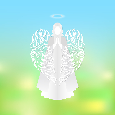 Angel with ornamental white wings and glowing nimbus. Beautiful angel silhouette with delicate wings. The praying white angel on a background of sky and green abstract background. Angel soaring in the sky. Postcard to a religious holiday.