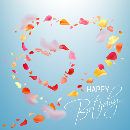 Colorful photo realistic rose petals flying in heart shape and white hand writing text Happy Birthday on a light blue background. Petals in different shape and focal distance, big, small, blurry.