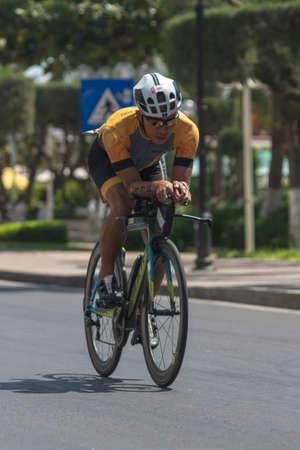 Minh Anh Tran Dinh a triathlon competitor in Challenge Vietnam rides a Bicycle along Tran Phu street near the South China sea Redakční