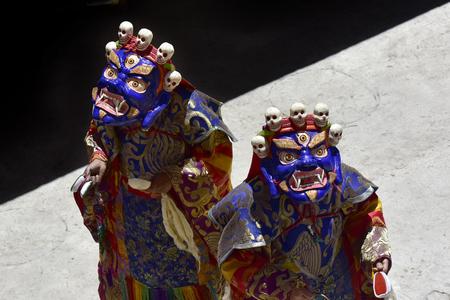 Lama Dance in Buddhist Masks and festive ethnic dress, the monastery of Karsha Gonpa, Zanskar, the Himalayas.