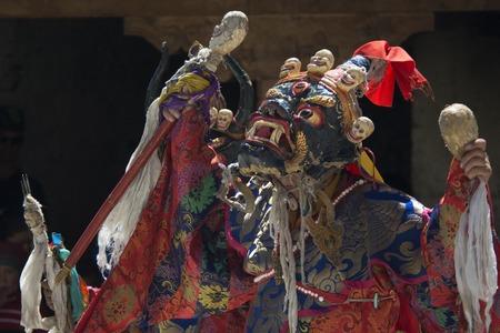 Buddhist lama high tantric initiation performs Dance Mask in ritual Tibetan clothing at the festival in Zanskar, India.
