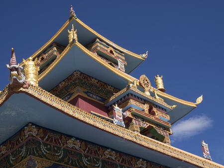 Roof of a Buddhist monastery with traditional Tibetan decorations and patterns.