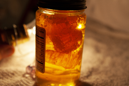 natural honey sweetener in a jar with golden yellow lighting