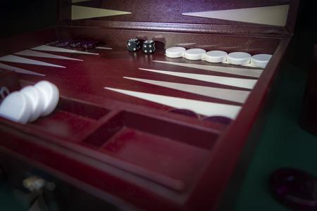 maroon, white and black backgammon board game set