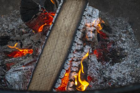 burning tree logs on an outdoor open fire