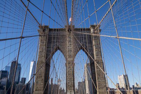 Famous Brooklyn bridge on a clear blue shy day of the manhattan island