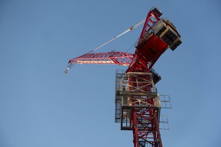 low angle looking up at a high elevation building construction crane 版權商用圖片