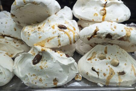 italian white Meringues biscotti with almonds and caramel