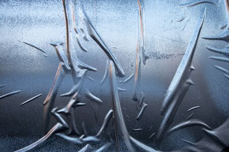 uneven crinkly gued silver blue spray painted wall paper poster effect Фото со стока