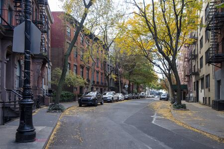 fall in downtown new York city Greenwich Village street with brown stone homes