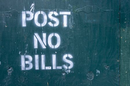 post no bills spray painted text letters on closed off unrban contrustion area Foto de archivo