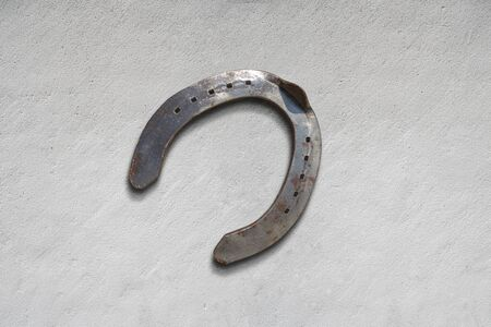 meatl horseshoe for luck and wellness on a cemete surface