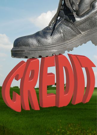 A workmans boot crunching the word credit photo