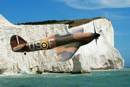 Spitfire over the white cliffs of Dover England