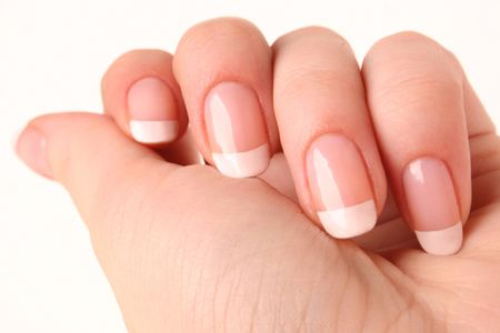french manicure: Woman�s hand with French manicure 01