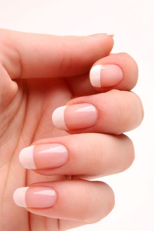 feminine hands: Woman�s hand with French manicure 02