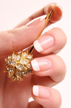 hairpin: Woman�s hand with French manicure and glitter hairpin