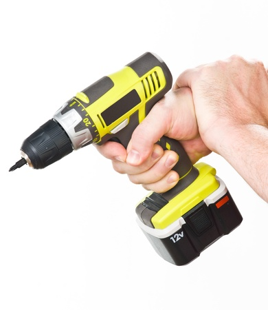 disassemble: hand with electric screwdriver Stock Photo