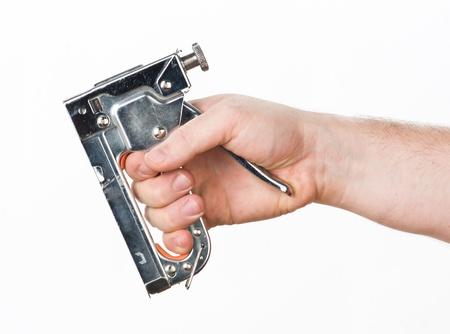 grapa: mano con la pistola de grapas