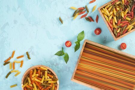 Pasta assorti on blue background with box 写真素材