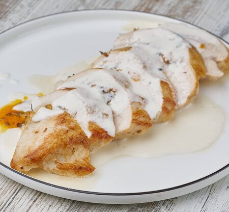 chicken breast sliced stuffed with sauce
