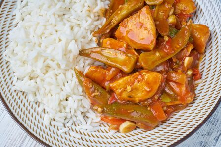 vegetable stew with rice on plate