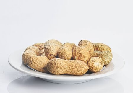 peanut in white plate isolated