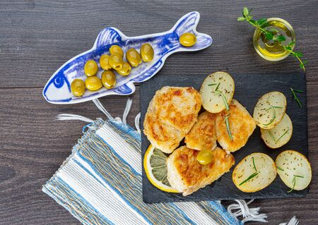 rustic baked cod with potatoes on gray Stockfoto