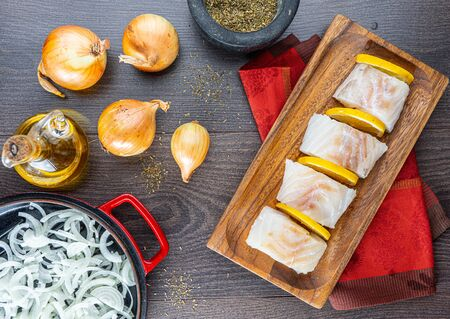 chopped cod on a wooden board on white