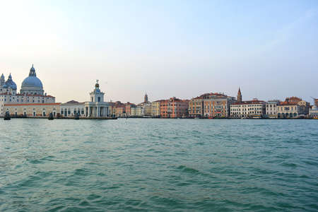 italy venice lagoon cityscape from boat at sunset