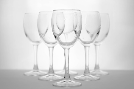 crystal glass: Wine glasses on white and gray background for text