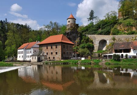 An old water mill on the river in the South Bohemian.