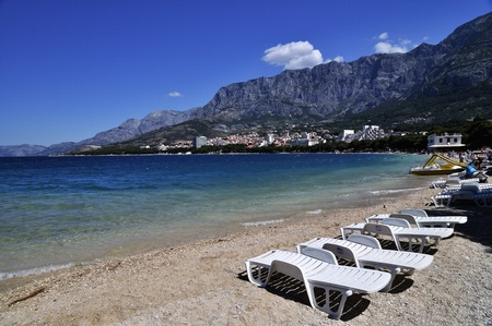 Deckchairs on a beach of Makarska, Croatia photo
