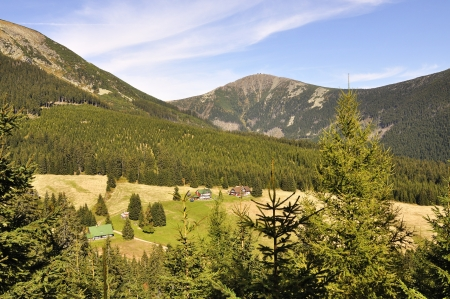 chalet and hill Snezka in the national park Krkonose Czech photo