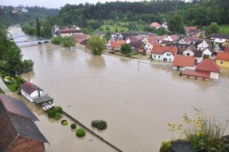 strongly: Flooding river Luznice, Czech Republic, village - Bechyne