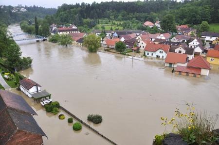 flood: Flooding river Luznice, Czech Republic, village - Bechyne