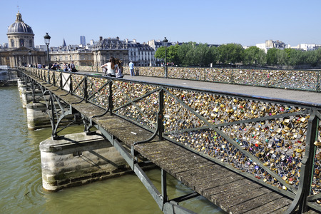 Lovers have locked thousands of locks to the Pont des Arts bridge in Paris. The padlocks, with keys thrown into the Seine River, is a modern tradition Editorial