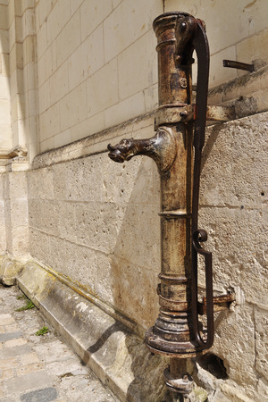 Medieval (retro) iron water pump, France Stock Photo
