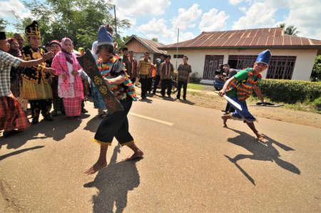 Kolaka, Indonesia - November 16, 2011: Tarditional war dancers when welcoming a bridegroom to a wedding