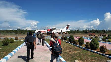 KOLAKA, INDONESIA - January 10, 2019: Passengers who want to board a plane at Kolaka Nibandera Sangia Airport before pandemi Covid-19.